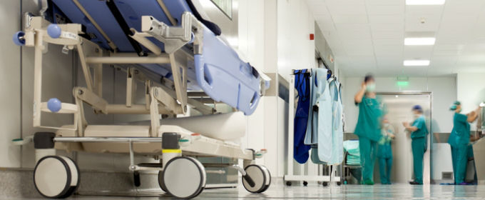 Shot of hospital ward with doctors in background