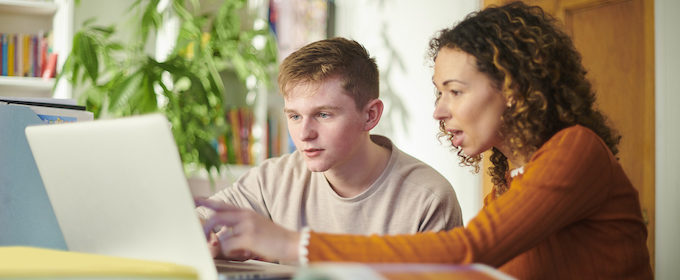 Student with tutor in one to one tutorial