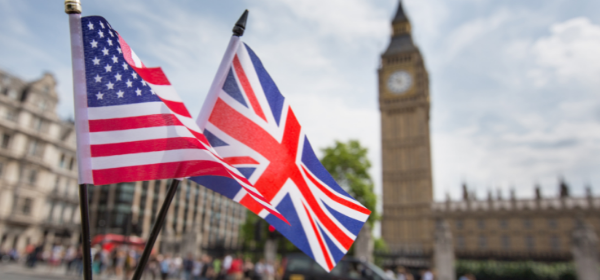 United States flag and United Kingdom flag flying outside UK Parliament