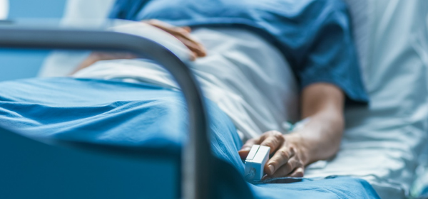 Patient lying down in hospital bed